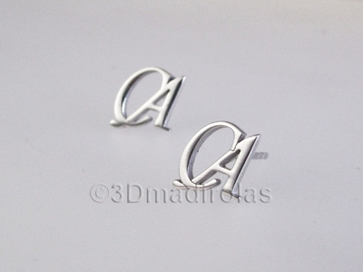Silver earrings with  two Capital letters.