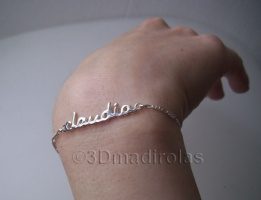 Silver wrist chain with a one NAME.